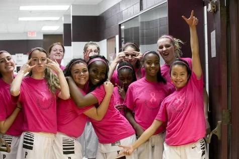 Girls basketball raises $1,000 for breast cancer awareness