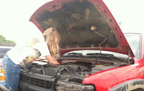Senior Emma Kaulbach works on her truck