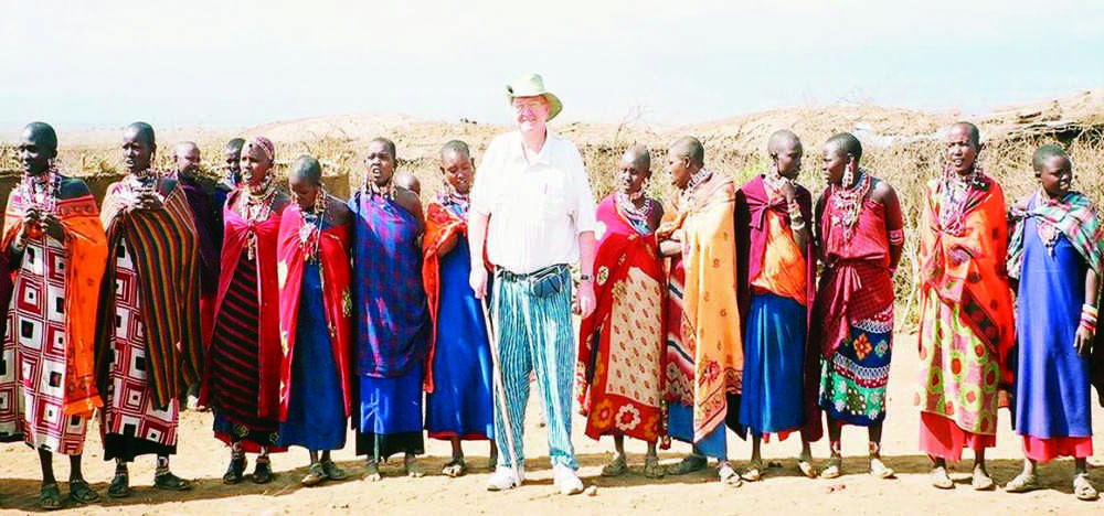 Milt+Enright+visits+a+village+in+Africa.+He+is+welcomed+by+Maasai+people%2C+who+then+welcome+him+into+their+culture.+