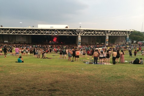 Rain clouds pass over drenched fans at the Gexa Energy Pavilion.