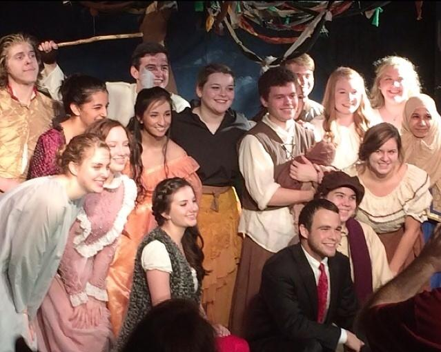 The+cast+of+Into+the+Woods%2C+a+student+based+theater+production+seniors+Jason+Head+and+Maggie+Harvey+collaborated+on%2C+shares+a+smile+in+a+group+photo.+We+had+a+plethora+of+talented+actors%2C+Harvey+said.+