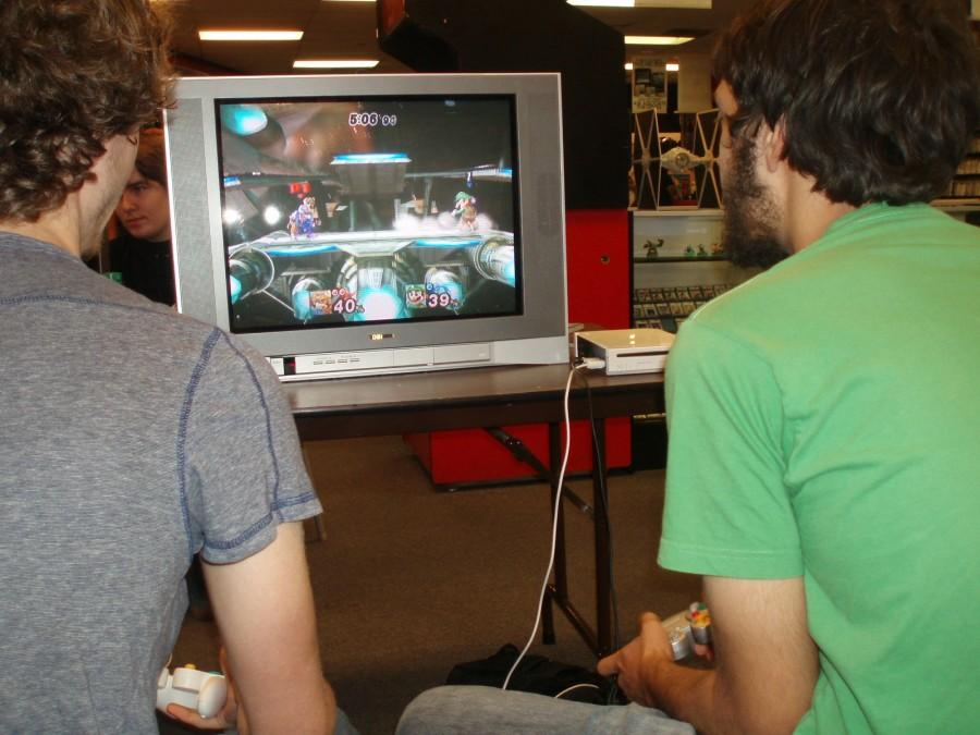 Two Smash gamers play against each other in Project M using the characters Fox and Luigi. Photo by Min Ji Kim.