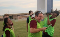 Spanish Club sponsor Greg Shields is showered with ice water after his clubs team takes the victory in penalty kicks. Photo by Haley Samsel.