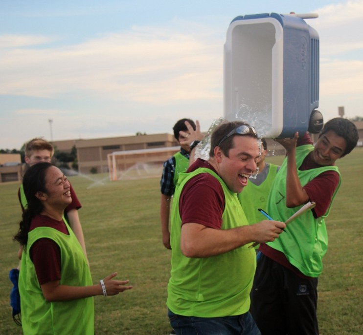 Spanish Club sponsor Greg Shields is showered with ice water after his club's team takes the victory in penalty kicks. Photo by Haley Samsel.