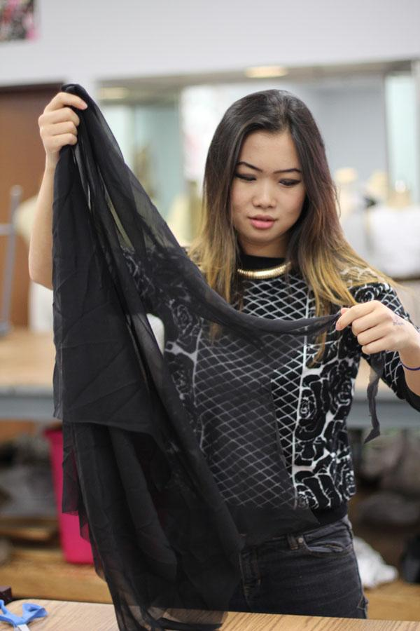 Senior Vickie Lin, a designer for the fashion show, works on finalizing her creation.