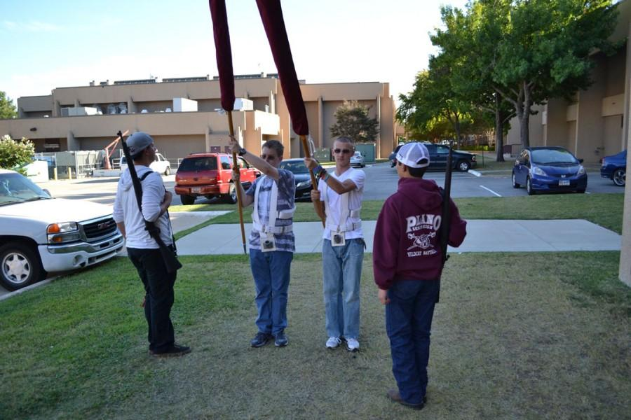 Members of the color guard prepare for the meet that took place Nov. 1. Photo by Parker Matthews.