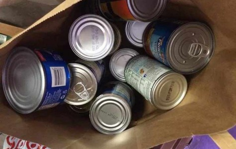 Boxes full of cans like these will be heading to the Plano Santas' warehouse after the canned food drive concludes.