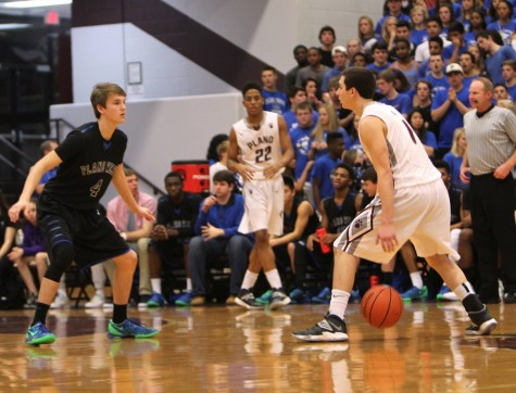 The Wildcats take on the Wolves during a game last season. Photo by Terry Quinn.