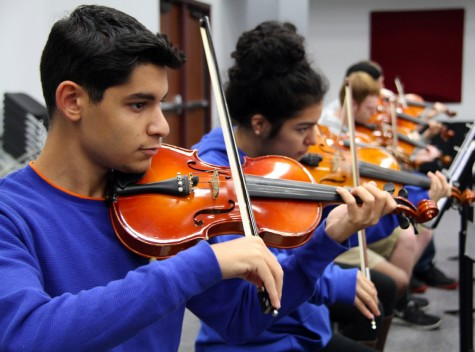 Orchestra students prepare for the upcoming concert during the month of November. Photo from yearbook archives.