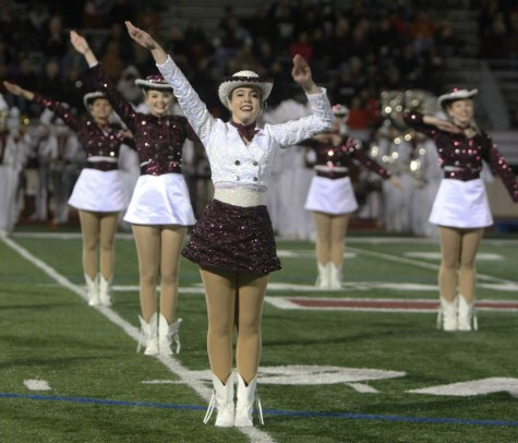 Planoettes perform at halftime of Plano's playoff game against Denton Guyer at Cowboys Stadium last fall. Photo by Terry Quinn.