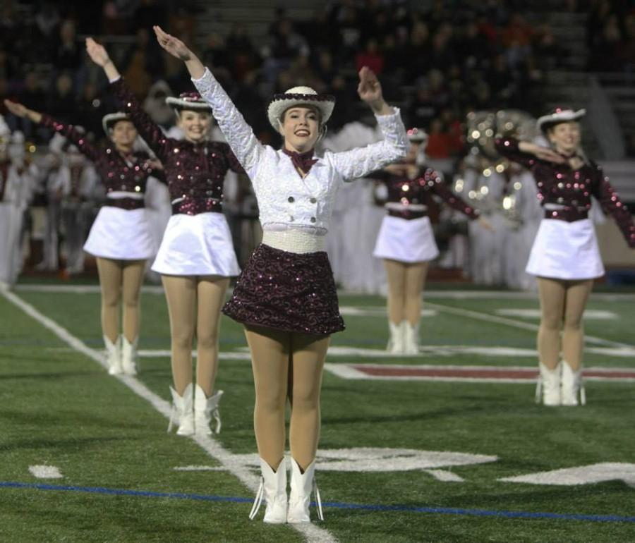 Planoettes perform at halftime of Planos playoff game against Denton Guyer at Cowboys Stadium last fall. Photo by Terry Quinn.