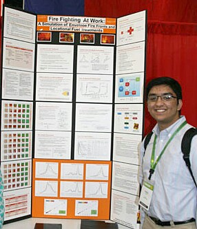 """Rajesh presents the results of his project at the 2014 International Sustainable World for Environment Engineering and Energy Project Olympiad. """"My models implement locational fuel treatment to study preventative techniques against wildfires,"""" Rajesh said. Photo submitted by Vishal Rajesh"""