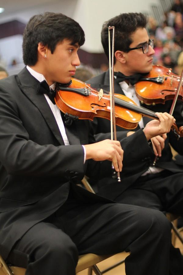 Senior Jose Orta plays in the orchestra's winter concert in early December. Photo by Kacie Shehane.