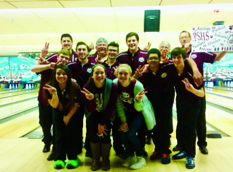 The boys bowling team poses for a photo with members of the girls team after placing second at the regional competition.