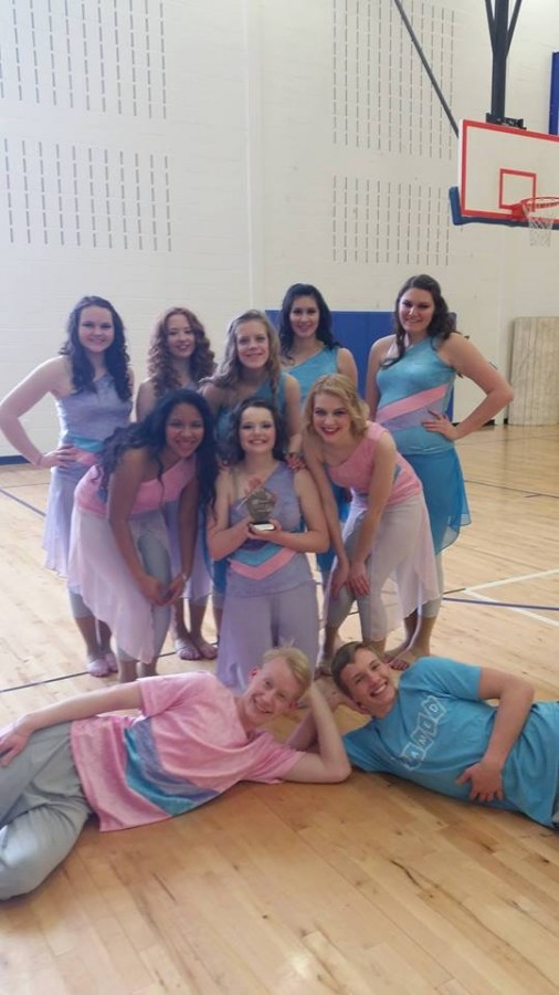 Guard members hold a trophy from their most recent contest. We won second place at the competition, junior Erin Andereck said. It was the Saturday after spring break so we were missing four people, unfortunately. Photo submitted by Erin Andereck.