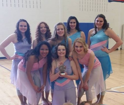 "Guard members hold a trophy from their most recent contest. ""We won second place at the competition,"" junior Erin Andereck said. ""It was the Saturday after spring break so we were missing four people, unfortunately."" Photo submitted by Erin Andereck."