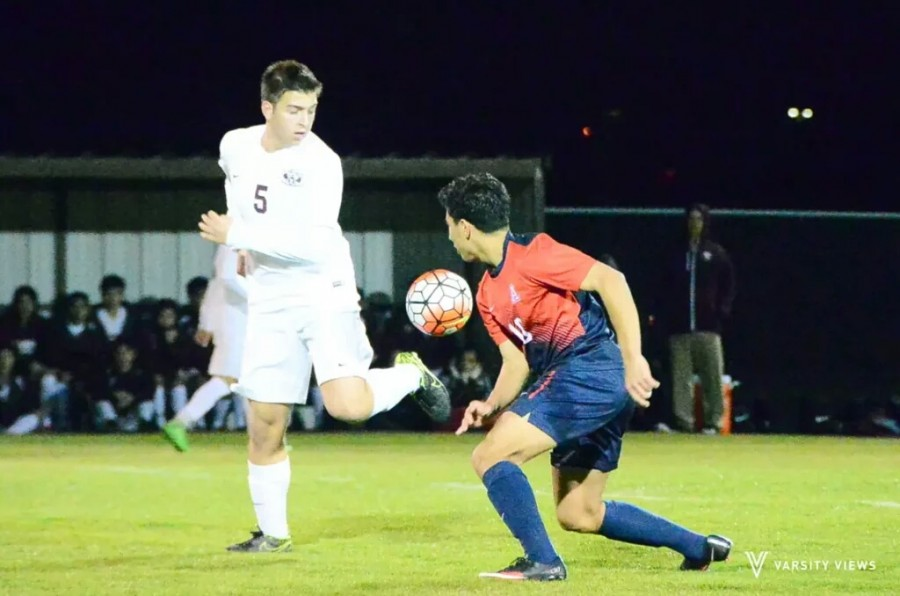 Jon Roth attempts to flick the ball on during the varsity game against Allen on Jan. 19. The match ended in a 2-2 draw. Photo credit to Varsity Views.