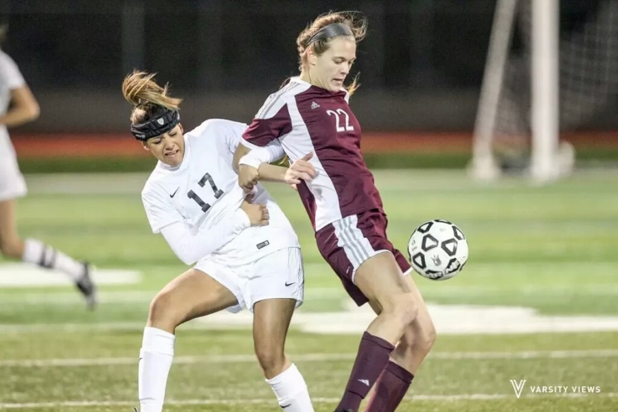Senior #22 Claire Gantzer controls the ball in the varsity match against Lewisville on Jan. 12. The game finished in a 3-0 win for Plano.  Photo credit to Varsity Views.