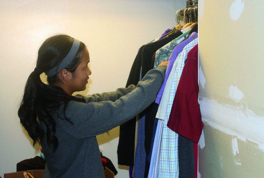 Senior Eena Lin works to organize and restock Plano's Closet. (Photo by Grace Tsichlis)