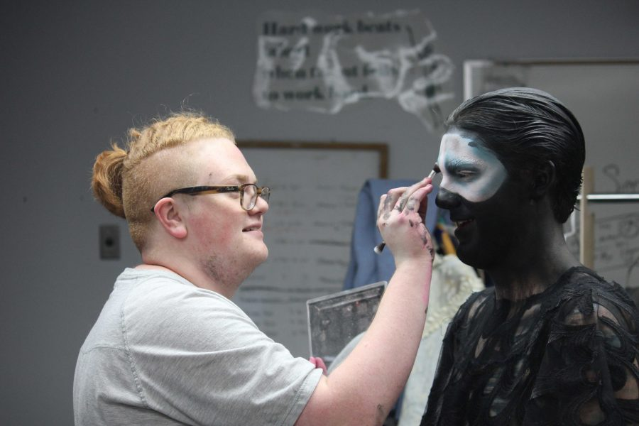 Senior Kolten Yeck does theatre makeup, which includes Tanner Lewis and Olivia LaBounty's makeup for The Lost Boy. (Photo by Arielle Raveney)