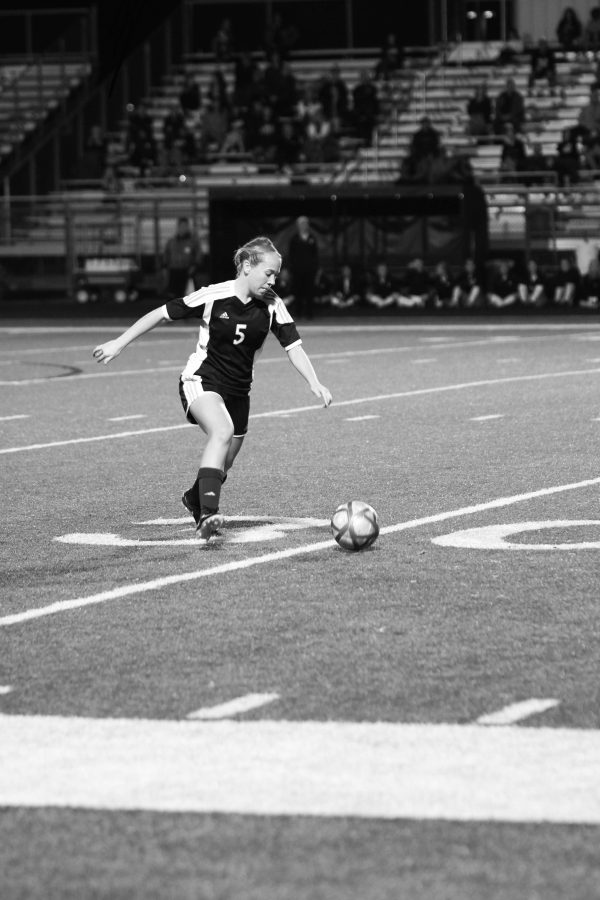 Senior Emma Bonin dribbling the ball during a game.