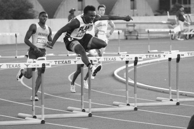 (Right) Senior Charles Brockman competes in the hurdles race. (Photo by Shelton Jolivette)