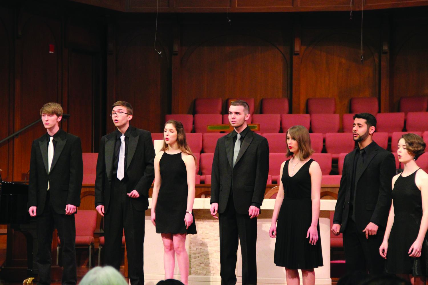 (Left to right) Seniors Sam Van Duyne, Jeffrey Kozlowski, Jenni Hutson, Zach Johnson, Heather Peters, Saman Maghami and junior Cannon McClure singing in the Chamber choir concert.