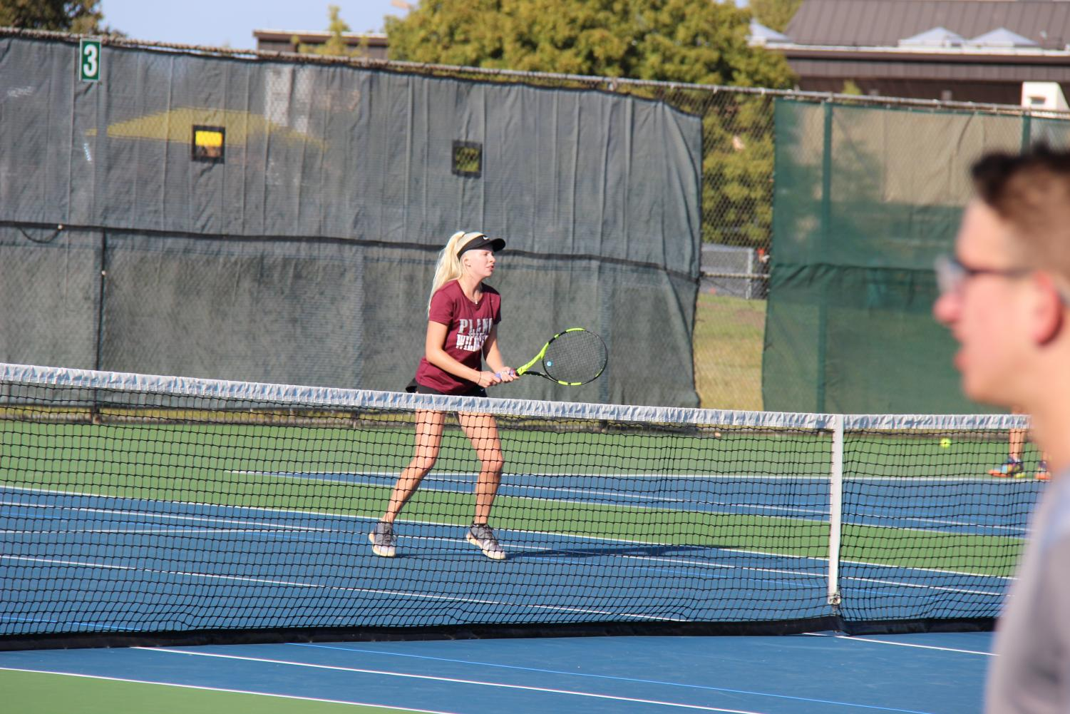 Junior Mikaela North waits for the ball during the district match.