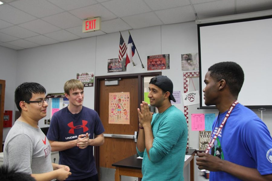 Seniors Jesus Barco, John Brown, Vinay Mehta and Evan Hedroe get to know each other during a meeting of the Plano Positivity Club.