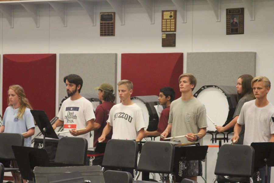 Seniors Jack Myer, Evan Cure, Andrew Ritz, and junior Alex Martino rehearse for the Drumline Competition