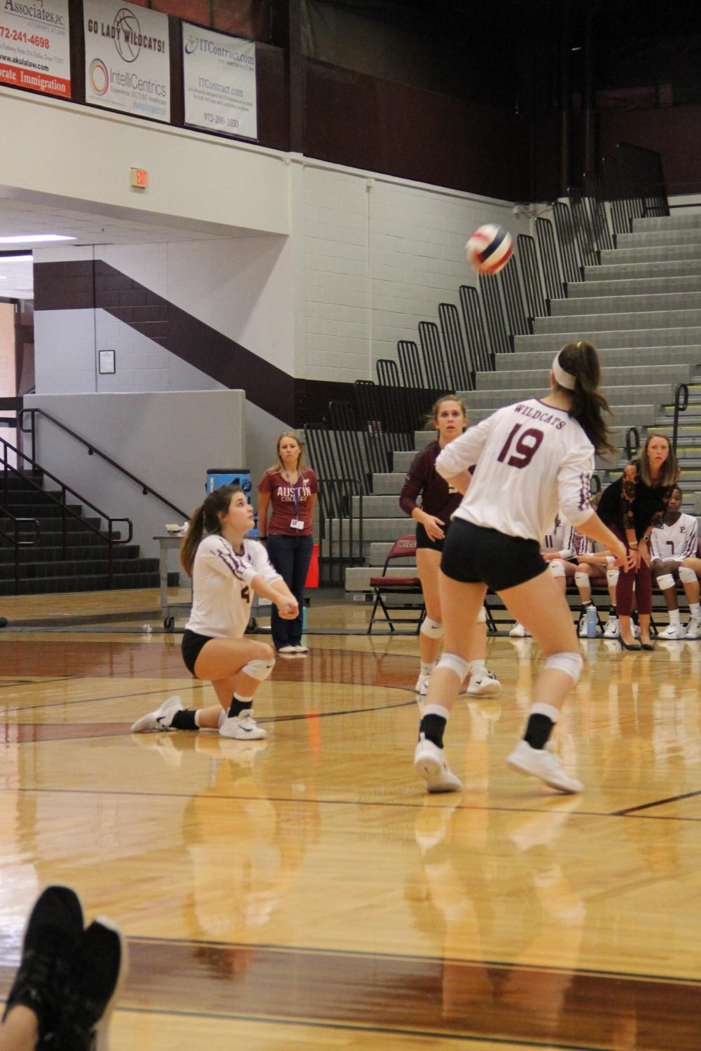 Junior Grace Glasscock (left) returns a serve and sophomore Kristen Barnard (middle) and junior Rachel Howes (right) wait to assist.