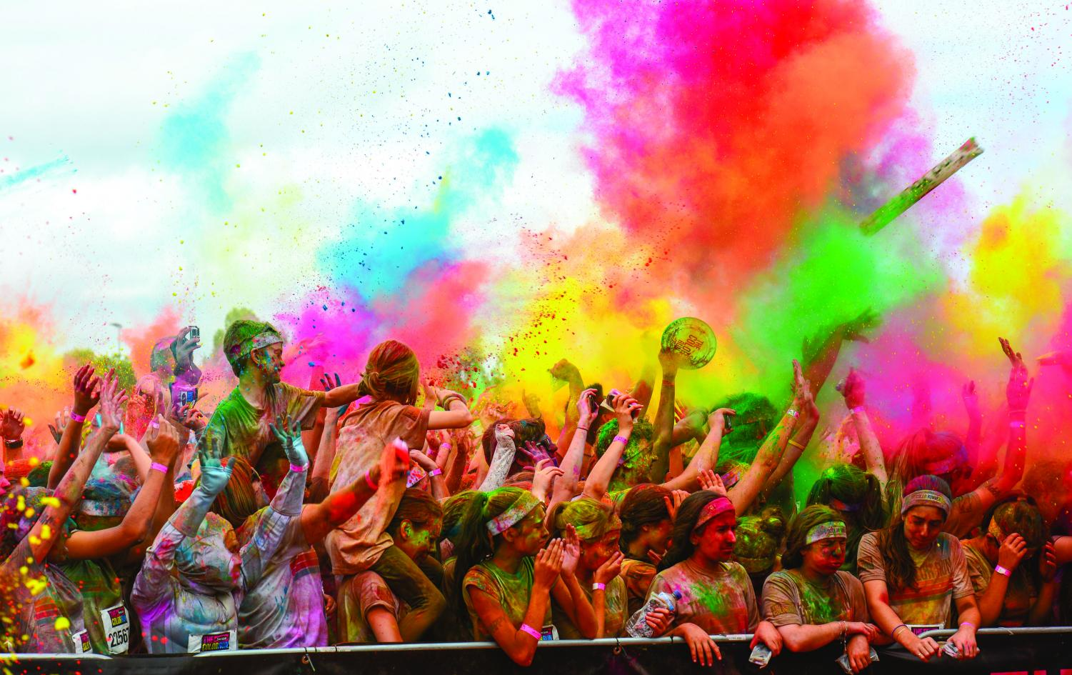 Participants in a charity color run enjoy flinging colors on themselves and other participants during one of the popular events. (photo used with permission by Wikimedia Commons)