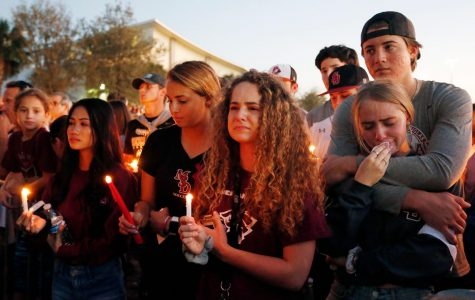 Students from Marjory Stoneman-Douglas High School pay tribute to fallen teachers and students during a candle light vigil. (photo used with permission by Getty Images)