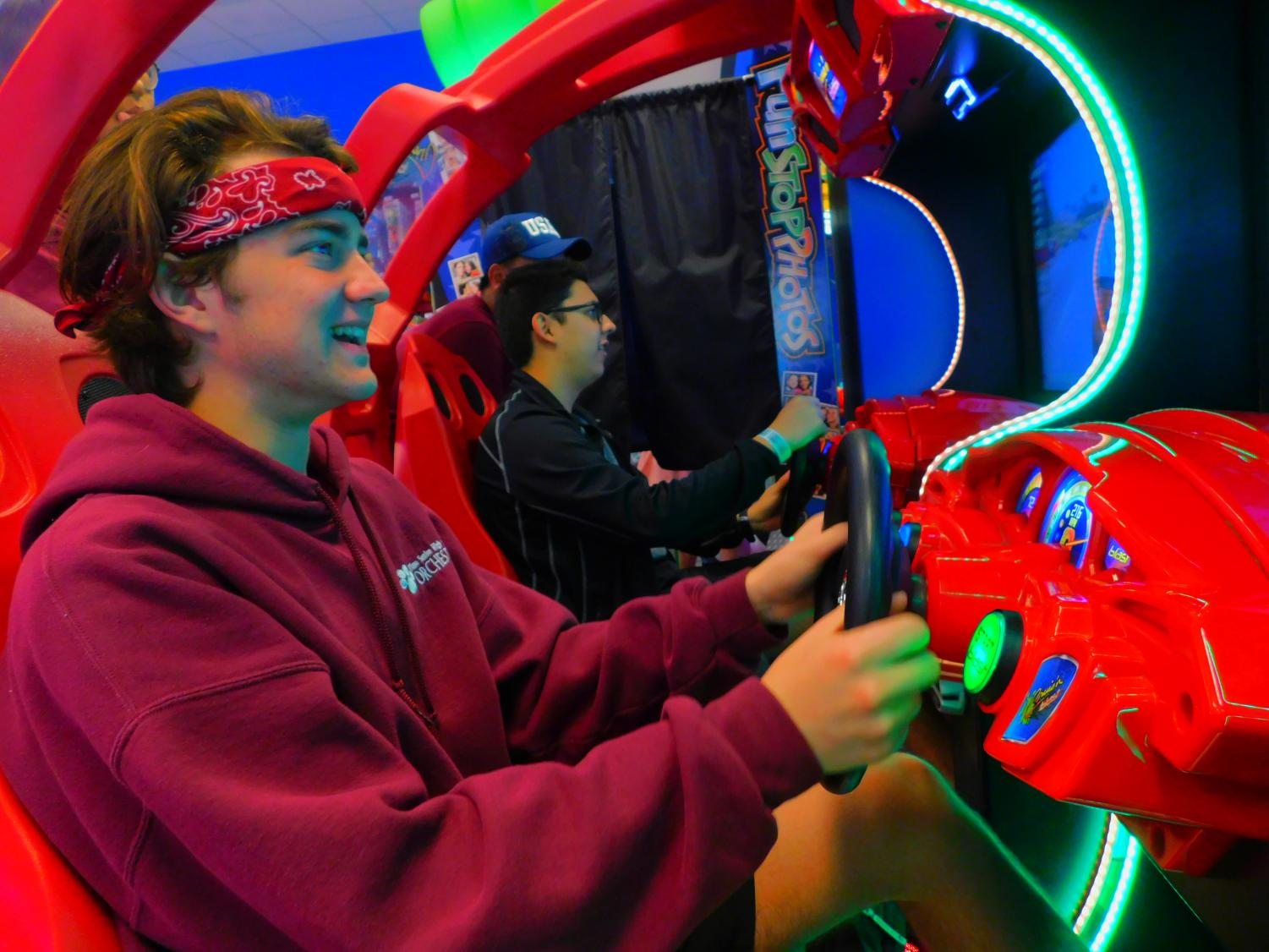Juniors Jackson Freeman and Daniel Restrepo play games at an arcade in Branson, MO on the orchestra trip. (photo by Ethan Nguyen)