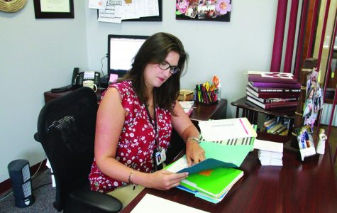 New associate principal for curriculum, Coryn Prince, looks over the day's work in her new office. She comes to us from Jasper High School. (photo by Katie Gallaway)