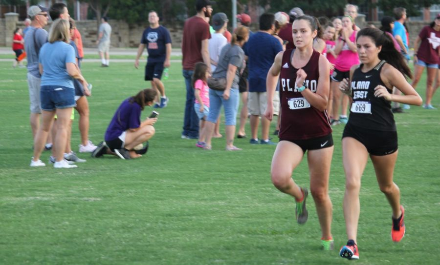 Brooke+Dixon+pushes+herself+to+get+past+a+runner+for+Plano+East+at+the+Plano%0AInvitational+Cross+Country+meet.