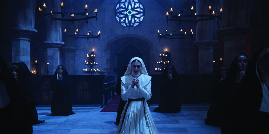 Sister Irene (Taissa Farminga) praying to keep evil spirits away from the abbey in The Nun. (photo by used with permission from New Line Cinema)