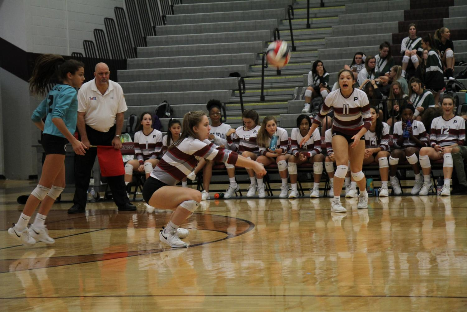 Naylani Feliciano (left) Grace Glasscock (middle) and Brooke Mchale (right) setting up a play during the game.