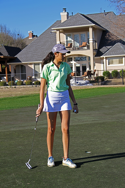 Senior Nikki Patel after finishing a hole.