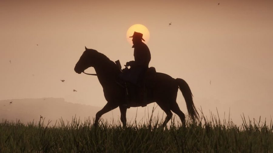 Cinematic+shot+of+a+lone+cowboy+riding+trusty+steed+at+sunset