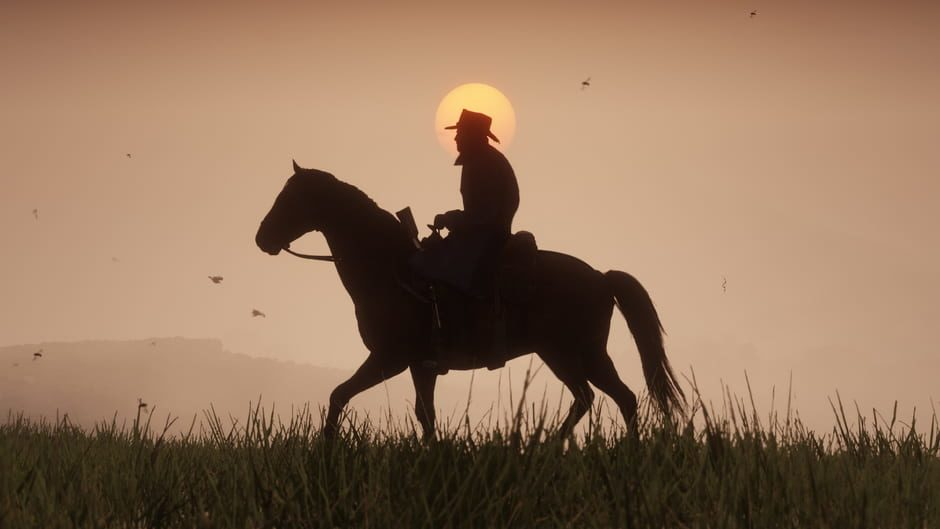 Cinematic shot of a lone cowboy riding trusty steed at sunset