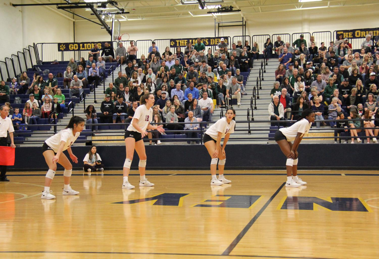 Lady Wildcats Trinidy Huynh, Julia Adams, Evie Bordeaux and Rutendo Chando line up for a play at Mckinney Boyd