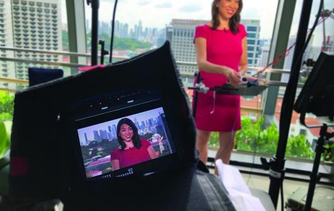 Elise Hu broadcast reporting from Singapore for National Public Radio Station.