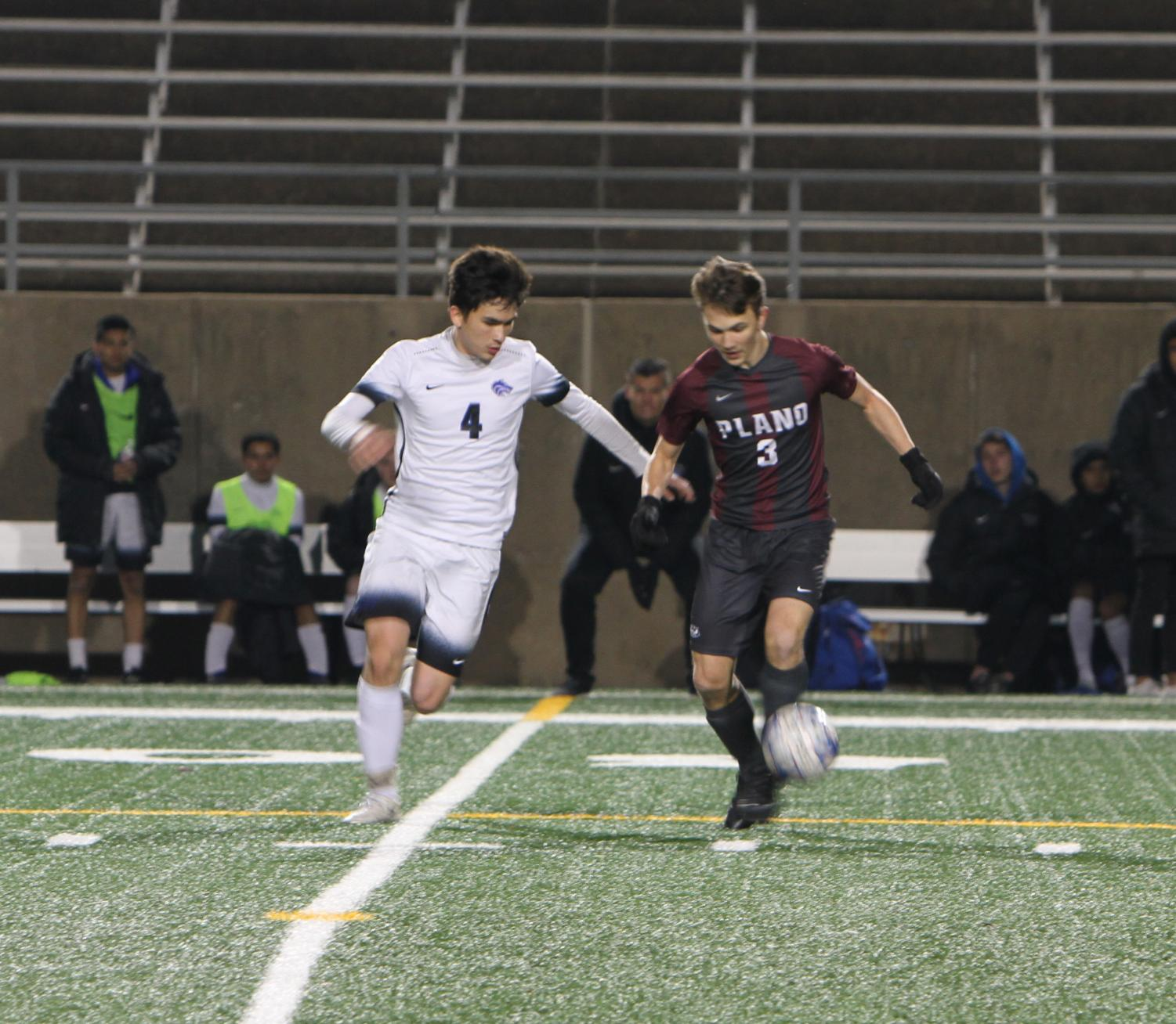 Player number three, Zach Hopkins, fights to keep control of the ball in mid-field.