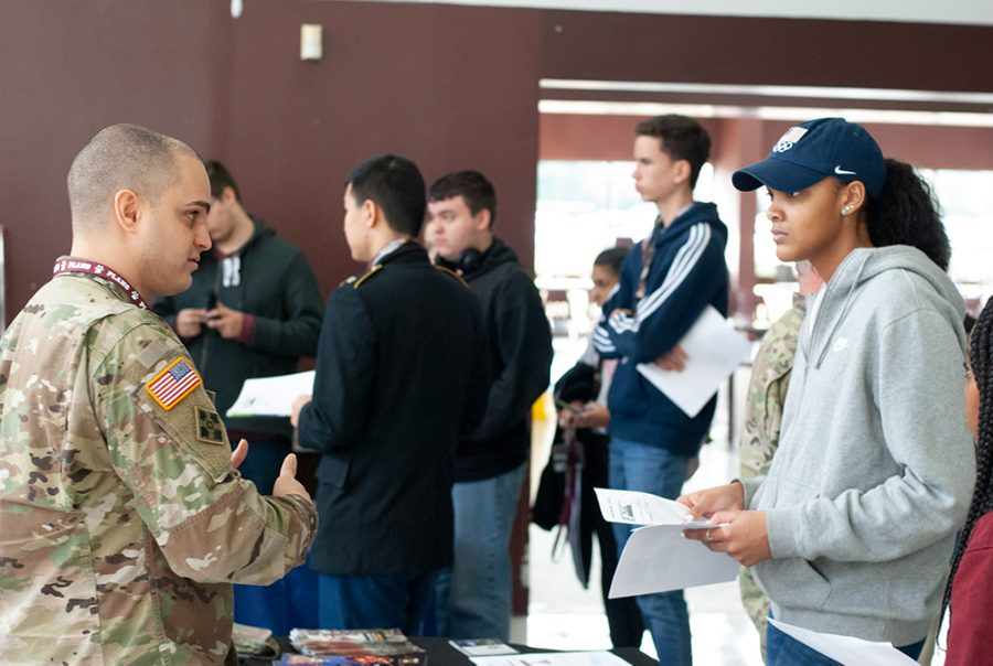 Army recruiter providing information to students about opportunities