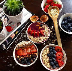 Healthy breakfast fruit bowl with nuts, fruits and grains.