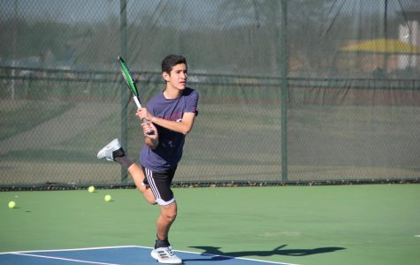 Freshman Herman Aguirre swings at Wildcat tennis court.