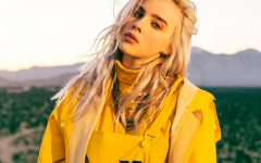 Billie Eilish poses while showing off her yellow inspired outfit.
