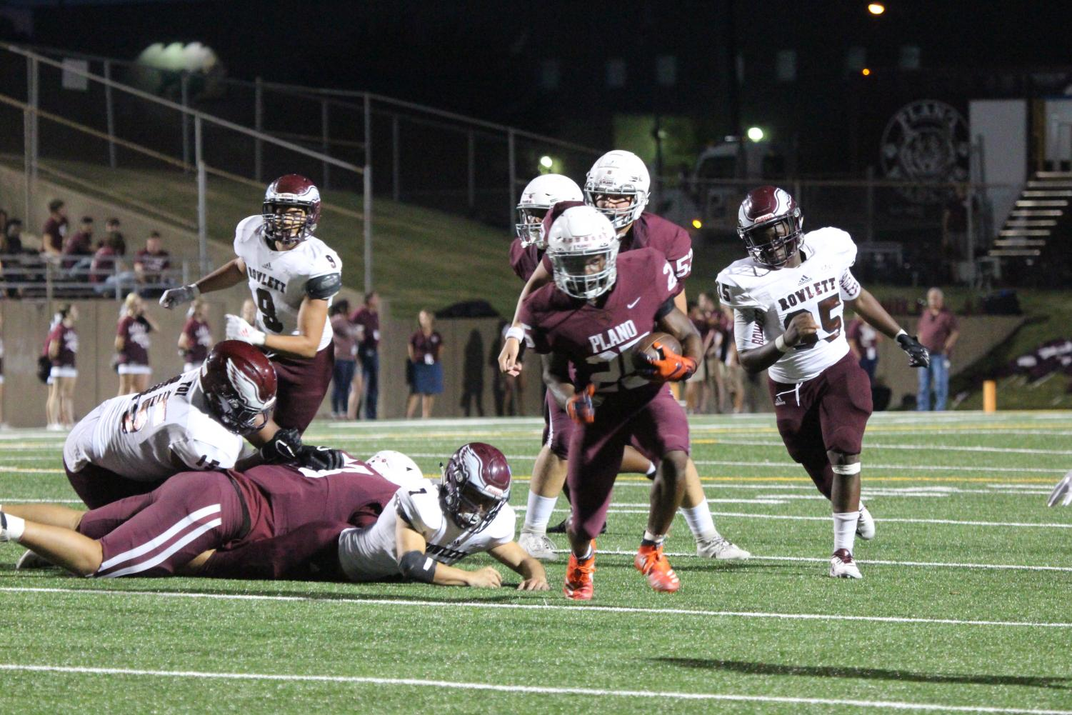Running back Tylan Hines running the ball down the field in the Plano vs. Rowlett game.