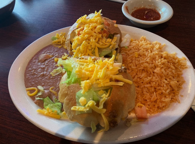 Ojeda's delicious puffy taco dinner with rice and beans is a signature dish at the traditional Mexican food restaurant located at 2001 Coit in Plano. (photo by Dylan Kinney)